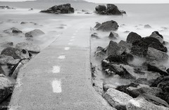 Path to Infinity (Allette Snijder) Tags: longexposure ireland sea bw dublin seascape nature water monochrome landscape daylight seaside rocks soft zwartwit path sony minimal serene milky noirblanc sandycove nd9