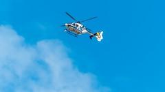 POLICE HELICOPTER (martincorderi) Tags: police vigo helicopter air blue sky spain policeman clouds policia red helicoptero españa