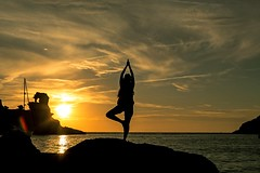 Yoga at sunset (Pankcho) Tags: sunset sky woman beach silhouette yoga backlight contraluz atardecer islands chica tranquility playa cielo silueta islas menorca gir baleares tranquilidad balears illes calamorell