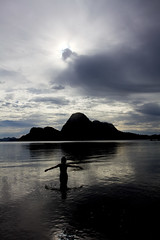Lady in Black (PacificKlaus) Tags: ocean sky reflection philippines elnido palawan