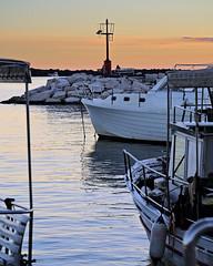 Good night boats (senza senso) Tags: sunset sea lighthouse boat croatia istria darktable