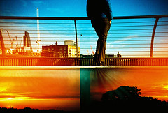 Lomo  sunset in his pocket (lomomowlem) Tags: city sunset red urban orange london lomo lca xpro lomography xprocess doubleexposure crossprocess lofi millenniumbridge analogue split halfframe expiredfilm misaligned colourstreambrighton
