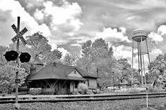 Andersonville Depot 2 (Neal3K) Tags: trees sky bw sunlight clouds georgia ir blackwhite watertower gray depot watertank andersonvillega infraredcamera rrtracks vintagebuilding rrdepot rrsignal 590nmir kolarivisionmodifiedcamera