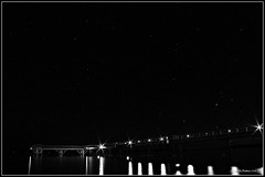 Star Lights (CanMan90) Tags: longexposure bw canada canon reflections outdoors lights pier blackwhite nightshot britishcolumbia vancouverisland wharf sidney sidneybythesea cans2s rebelt3i