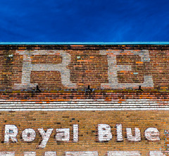 a building named for the sky (Noel Leone--my reality in and out of focus) Tags: sky advertising washington bricks lookingup porttownsend royalblue oldbrickbuilding