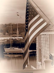 Seaside Holiday (Professor Bop) Tags: professorbop drjazz olympusem1 rockportmassachusetts americanflag sepia boat independenceday fourthofjuly
