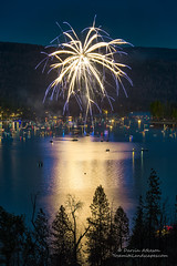 Fireworks over Bass Lake (Darvin Atkeson) Tags: california light lake snow mountains reflection water rain forest day glow fireworks bass nevada 4th july sierra pines shore independence 4thofjuly basslake oakhurst elnino 2016 darvin atkeson darv lynneal yosemitelandscapescom
