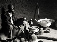 Marcel (yrotori2) Tags: africa man home monochrome casa blackwhite african bn uomo afrika benin interno noirblanc afrique bénin catino cereali somba abitazione atakora bacinelle