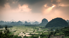A Burst of Light over the Rice Fields (awhyu) Tags: sunset mountains landscape photography rice paddy guilin yangshuo andrew fields yu karst