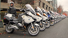 Police Motorcycles Lined Up (planephotoman) Tags: motorcycle motorcycleunit policedepartment sheriff officerlibkememorialprocession november142013 oregoncitypoliceofficer oregoncityreservepoliceofficer robertlibke officerrobertlibke veteransmemorialcoliseum portlandor bmw
