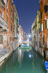 Canal in Venice (Mats Silvan) Tags: road street door old longexposure travel bridge venice houses sea sky italy holiday reflection building window water lamp architecture night outside star living boat canal alley colorful streetlamp antique balcony transport illuminated reflected bluehour mirrorimage mozart startrails veneto veniceitaly