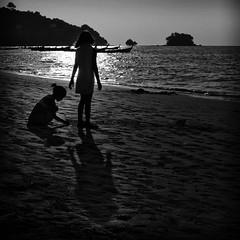 marking the birth of a friendship~ phuket (~mimo~) Tags: travel girls sunset shadow blackandwhite holiday beach silhouette children square thailand asia phuket backlighting naiyang mimokhairphotography