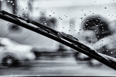 Wipe off the rain drops (alexlv10) Tags: street blackandwhite black window water rain moody silent traffic wind sony drop brush diagonal busy half wiper nex sel50f18 sonynex5t