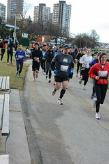 First Half Feb 16 2014 090046 (gherringer) Tags: canada vancouver race outdoors athletics downtown bc exercise britishcolumbia competition running seawall runners englishbay stanleypark colourful westend fit active bibs 211km 131mi vanfirsthalf 2014firsthalfhalfmarathon