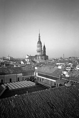 Roofs (emanuele_f) Tags: panorama film wheel landscape panoramic cupola neopan konica analogica 125 oneshot acros100 pellicola novara 24x36 r09 wide28