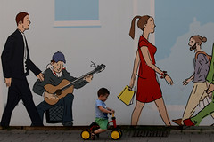 What song does the musician play? What do you think? (Wackelaugen) Tags: street canon germany painting photography eos photo driving child tricycle ludwigsburg googlies wackelaugen