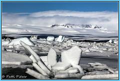 Jkulsrln 6842 (roswell433) Tags: snow mountains ice clouds iceland lagoon glacier east melt icebergs jkulsrln vatnajkullnationalpark