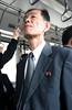 Coréen avec son pin's dans le bus à l'aéroport de Pékin (jonathanung@ymail.com) Tags: lumix asia pins korea badge asie nord northkorea corée dprk cm1 koryo coréedunord insidenorthkorea républiquepopulairedémocratiquedecorée rpdc lumixcm1
