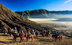 BROMO-TENGGER-SEMERU NATIONAL PARK, EAST JAVA, INDONESIA. (amrilizan photography) Tags: morning horse mountains nature silhouette clouds sunrise indonesia landscapes java nationalpark horsemen layers bromo humaninterest eastjava bromotenggersemerunationalpark mountbatok bromocrater gunungbatok