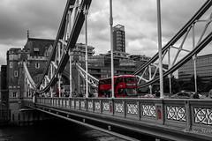 Iconic British double decker bus on Tower Bridge, London (Sue_Shaw) Tags: bridge red bus london towerbridge canon traffic transport iconic canoneos coloursplash doubledecker spotcolour canon60d