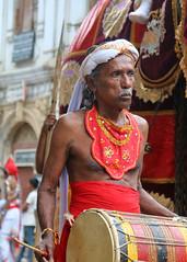 Perahera Portraits (IMG_3729b) (Dennis Candy) Tags: street portrait musician man heritage face festival costume day drum expression culture buddhism parade celebration elderly drummer srilanka ceylon procession tradition serendipity pageant hinduism kandy perahera serendib serendip esala