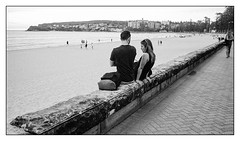 at the beach  #193 (lynnb's snaps) Tags: ocean bw woman man film beach coast couple 28mm sydney olympus apx100 rodinal 2016 om4 panfplus omzuiko28mmf35