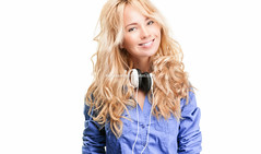 Young woman with headphones. (Konstantin Yolshin) Tags: blue portrait people music woman white cute girl beautiful beauty smile face smiling modern lady female youth hair studio happy person one model pretty looking expression background young posing lifestyle player teen listening blond trendy sound blonde attractive teenager headphones leisure cheerful enjoying enjoyment isolated phones earphones teenage listen 20s
