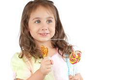 happy little girl holding two candies in her hands (Konstantin Yolshin) Tags: red portrait people food woman white cute girl beautiful beauty smile face look childhood smiling yellow female fun happy person kid holding funny colorful pretty child hand looking dress candy little sweet eating expression background joy daughter young adorable lifestyle happiness indoors human casual positive cheerful lollipop isolated hold caucasian