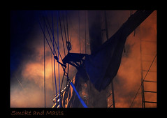 Fire on the Ship (poocher7) Tags: show sky clouds fire ship pirates smoke flames platform sails entertainment heat ropes tallship masts ladders gunfire livestageshow
