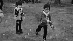 Our last holiday. (牧民沙蒙_MoominSamon) Tags: life girls blackandwhite bw white holiday black face last hair children fun glasses hands shoes child taiwan bubbles blow memory bubble catch taichung ours nikond7000