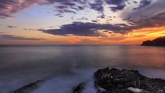 The quietness at the sunset (Enrico Cusinatti) Tags: longexposure sunset sea italy clouds rocks italia tramonto nuvole mare liguria rocce sori scogli lungaesposizione enricocusinatti