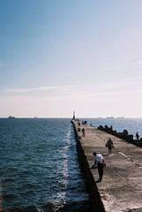 Did you catch it? (popo kuo) Tags: sea sky people cloud lighthouse film fishing kodak horizon taiwan kaohsiung    proimage100  konicasii