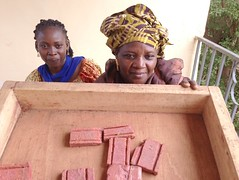 aissata and soap girl small (The Advocacy Project) Tags: africa training outdoors justice soap women peace quilting local mali income womensrights fellowship survivors trainingcenter soapmaking communitybuilding peacefellowship advocacyproject confidencebuilding sinisanuman