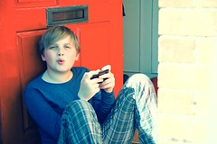 whistling on the front step (slightly everything) Tags: uk family boy england childhood europe technology son smartphone pjs letterbox doorstep whistling iphone realpeople katehiscock