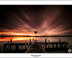 The Blast (John_Armytage) Tags: sunset reflection newcastle dusk belmont jetty australia nsw canon5d canon2470f28lusm leefilters squidsink leebigstopper johnarmytage wwwjohnarmytagephotographycom