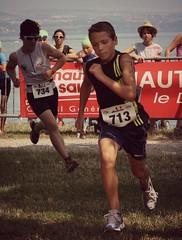 Running to the finish line (Cavabienmerci) Tags: boy lake france sports boys bike sport les kids race swim children see kid child geneva lac run runners leman runner triathlon junge garçon bains jungen genfer thonon läufer 2013