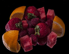 Fruit Palette (Bill Gracey) Tags: lighting red stilllife orange macro green fruit composition strawberry colorful watermelon fruta raspberry raspberries palette strawberrys naturemorte macrolens macrophotography foodphotography sidelight orangeslice directionallight offcameraflash tabletopphotography yn560ii yongnuorf603n