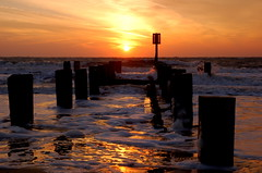 Soon after the sunrise, reflections on the breakwater (Kirkleyjohn) Tags: sun beach water sunshine silhouette sunrise waves silhouettes groyne breakwater lowestoft kirkley