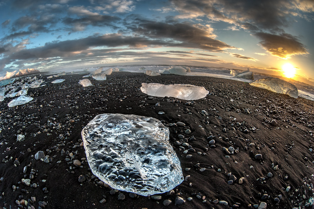 The Jokulsarlon black sand ice beach formed by icebergs breaking off of a nearby glacier then being carried to shore by the ocean tide.