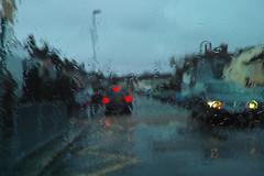 rainy school pick-up SDIM1085 (StefanSzczelkun) Tags: street distortion blur cars wet rain weather bad raining liquid throughawindow windowscreen 315pm schoolpickup