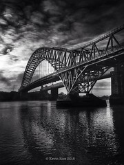 Moody Mersey (Grains of Rice) Tags: blackandwhite bw reflection water river mersey iphone runcorn widnes rivermersey runcornbridge iphonography snapseed