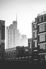 City in the Distance (tobylloyd) Tags: city travel england blackandwhite london skyscraper canon cityscape citylife kensington distance bricklane helios filmlens
