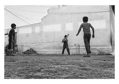 that's out! (handheld-films) Tags: travel blackandwhite india playing boys monochrome rural ball outdoors village indian games cricket bowling reportage wickets subcontinent madhyapradesh cricketers batsman howzat bowled