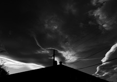 Poke (merripat) Tags: sunset sky blackandwhite white black clouds colorado skies telephone pole wires poke telephonepole telephonewires