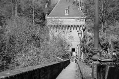 Love at the Gate (John fae Fife) Tags: blackandwhite bw candid streetscene luxembourg streetviews citygate pfaffenthal
