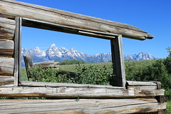 Grand Teton (ZoomSnapNext) Tags: flowers mountains west barn fence landscape nationalpark ngc meadow yellowstone wyoming grandtetons