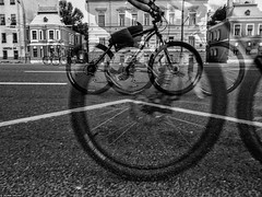 Bicycle race. Moscow (photozalman) Tags: street shadow people blackandwhite bw woman white man black reflection building art monochrome lines contrast shower mirror blackwhite shot russia outdoor geometry moscow creative streetphotography documentary lifestyle monotone structure best human elements streetphoto abstraction moment minimalism sity bnw avant bresson bwphotography symbolism bwphoto monoart