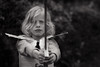 Knight in shining armour (Dalla*) Tags: summer portrait bw white black nature outside iceland kid child play reykjavik sword knight kidsplay childplay woodsword wwwdallais paperarmour