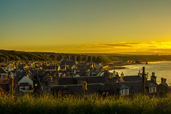 The Streets May Not Be Paved With Gold .......But Everything Else Is Covered In It (williamrandle) Tags: houses sunset sea sky beach buildings landscape evening spring nikon village outdoor dusk viaduct shore northsea serene moray goldenhour cullen goldenlight 2016 banffshire northeastscotland d7100 tamron2470f28vc