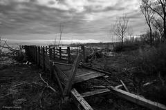Broken (Massimo_Discepoli) Tags: bw lake clouds mood trasimeno